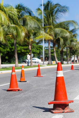 traffic   cones: Road construction works. Traffic cones at tropical street warning about asphalt pavement works Stock Photo