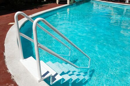 pool bars: Grab bars ladder in swimming pool, outdoors at the day time