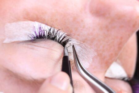 fascicle: Lash making process, extreme long lashes and tweezers, woman eyelash extension