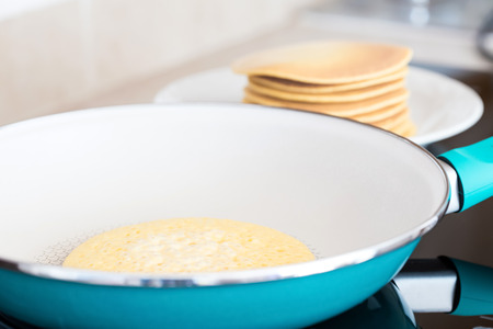 overturn: Making home made pancakes on frying pan, closeup Stock Photo