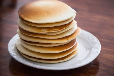 flapjacks: Stack of homemade pancakes on table, shallow dof Stock Photo