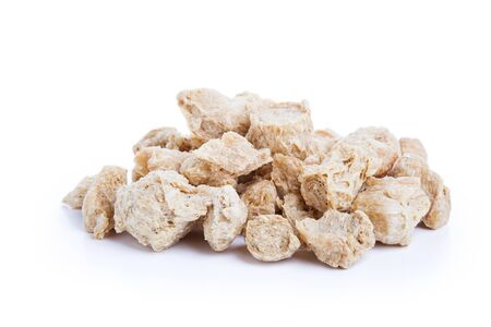 vp: Raw Soya Chunks, Soy Meat for vegans isolated on white background Stock Photo
