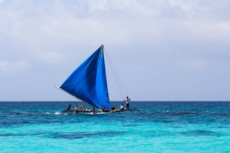 ketch: Boracay Island, Philippines - 11 November 2011: Local wooden sailing boat at the sea with people Editorial