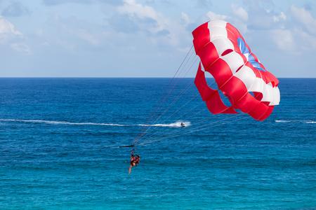 parasailing: Cancun, Mexico - 21 November 2015: Parasailing above caribbean sea