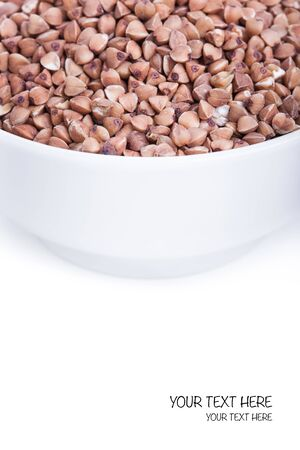 source of iron: Dry buckwheat in white bowl, source of Iron (Fe) Stock Photo