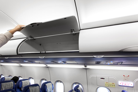 compartments: Passenger airplane interior with luggage compartments
