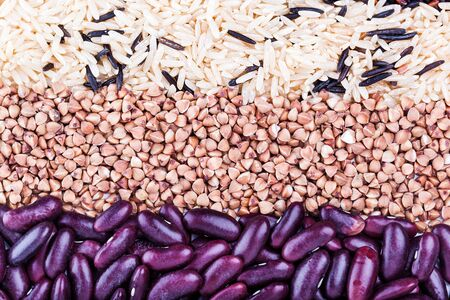 carbohydrates: Low carbohydrates in assortment,  rice, beans and buckwheat  top view, selective focus. Healthy food concept Stock Photo