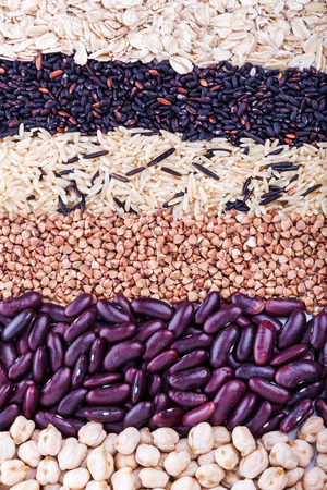 carbohydrates: Low carbohydrates in assortment, oat, rice, beans, buckwheat and chickpeas, top view, selective focus. Healthy food concept