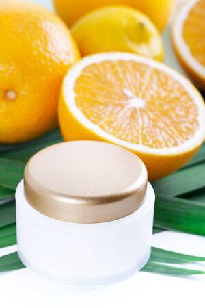 Facial cream with vitamin C, Orange fruit skincare Stock Photo
