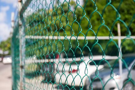 wire fence: Wire metallic fence, outdoors Stock Photo