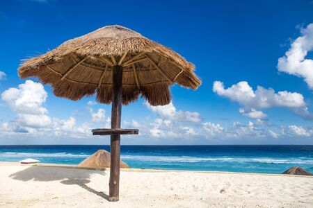 turquoise water: Sun umbrella on beautiful beach with turquoise water