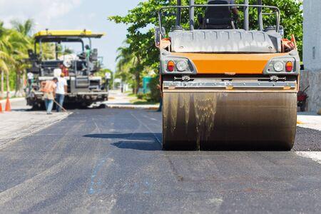 steamroller: Road construction works with steamroller machine and asphalt finisher Stock Photo