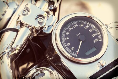 motobike: Motorcycle detail with mirror, speedometer and handlebar. Details closeup