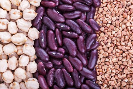 Low carbohydrates in assortment, beans, buckwheat and chickpeas, top view, selective focus. Healthy food concept