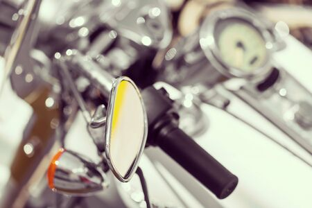handlebar: Motorcycle detail with mirror, speedometer and handlebar. Details closeup