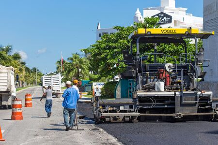 Mexico, Cancun - 10 October 2015: Workers making asphalt  at road construction