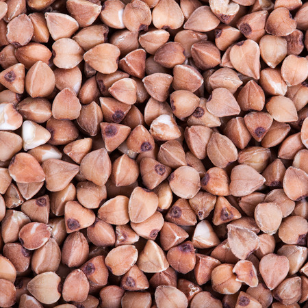 Dry buckwheat macro texture background, source of Iron (Fe), selective focus