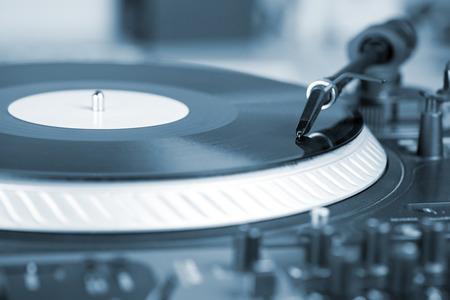 DJ needle on spinning turntable, closeup