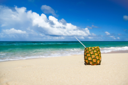 pina: Pina colada cocktail with pipe on beautiful sandy beach Stock Photo