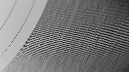 Closeup on grooves of record on turntable. Listening the music