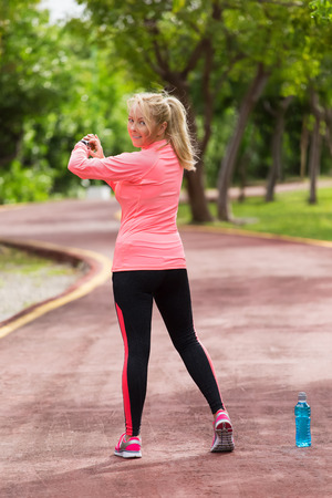 heart rate: Sports athlete runner woman looking at heart rate monitor after jogging. Healthy lifestyle and sport concept Stock Photo