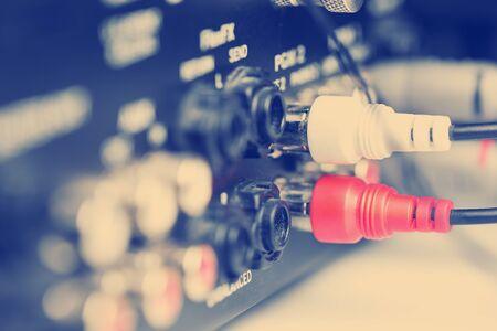 phono: Rca cables on back panel of dj mixer, closeup