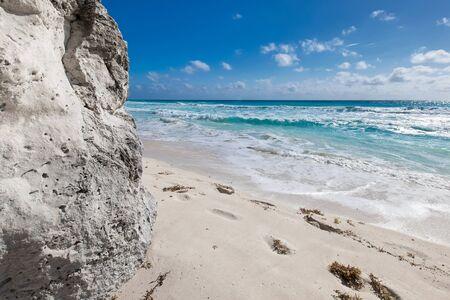 Ocean with waves and rocks on caribbean beach