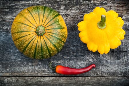 Pumpkin and pattypan, gardening vegetable on old wooden board Stock Photo