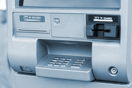 tone: ATM machine, outdoors. Closeup shot. Blue tone Stock Photo