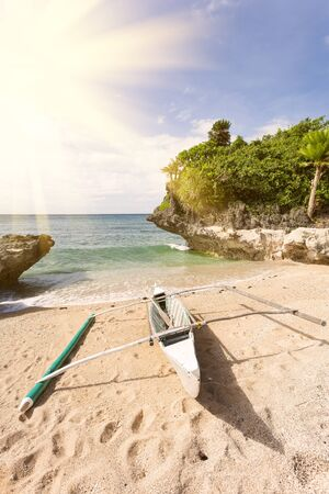 beachfront: Sailing wooden boat at the tropical beach