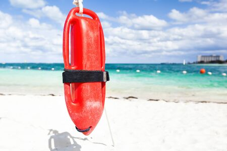 Red plastic buoy for a lifeguard ready to save people on sea background Stock Photo
