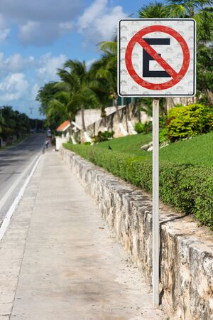Cancun, Mexico - 12 December 2015: No parking sign at the street road