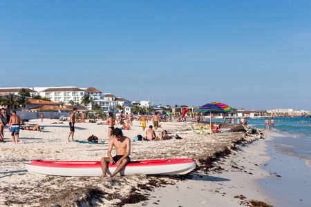 Playa Del Carmen, Mexico - 16 January 2015: People having fun on beach with different activities