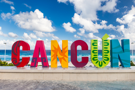 roo: Cancun, Mexico - 12 December 2015: CANCUN inscription in front of the Playa Delfines beach Editorial