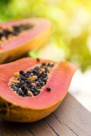 Slices of fresh cutted papaya on board, healthy detox concept Foto de archivo