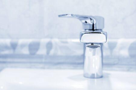 Modern metal faucet in bathroom, closeup