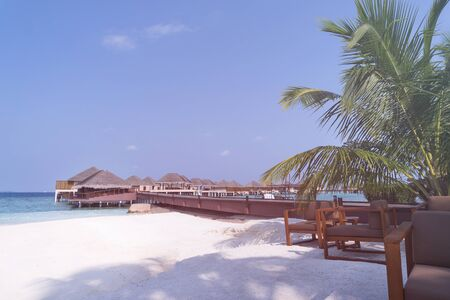 Tropical travel destination with pristine beach and water bungalows at maldivian island 에디토리얼