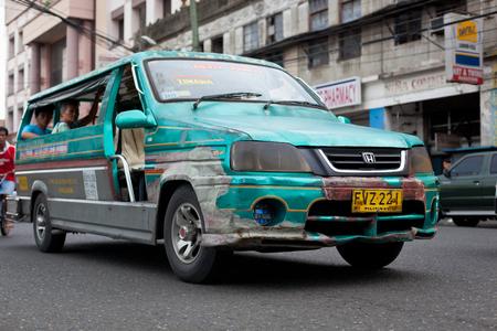 Ilo Ilo city, Philippines - 30 May 2013: Filipino taxi at the street Stock Photo - 102603655