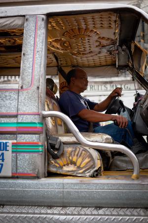 Ilo Ilo city, Philippines - 30 May 2013: Driver at filipino jeepney, close up