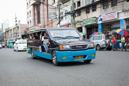 Ilo Ilo city, Philippines - 30 May 2013: Filipino taxi at the street Stock Photo - 102603687
