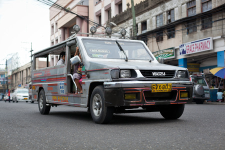 Ilo Ilo city, Philippines - 30 May 2013: Filipino taxi at the street Stock Photo - 102603704