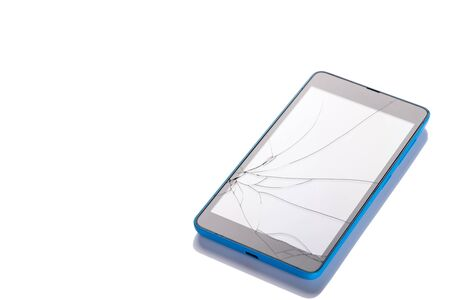 Broken screen on smartphone, closeup on white background