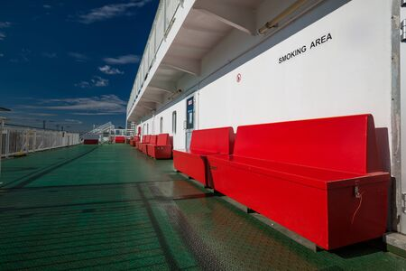 Bench with life jackets on upper deck of cruise liner