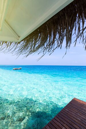 Tropical alcove on crystal sea, summer pergola on maldivian island, no people Stock Photo