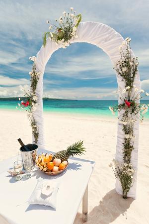 Beautiful wedding arch on tropical beach, nobody. Travel wedding destination, toned image