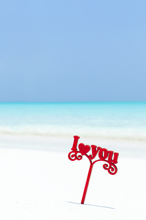 I LOVE YOU message decorated on white sandy beach, St. Valentines honeymoon romantic greeting card, loving travel