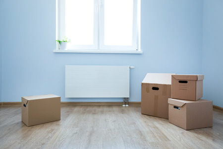 Cardboard Boxes On Laminate Floor In Empty Room Preparation Stock
