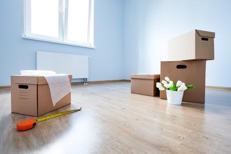 Cardboard Boxes On Laminate Floor In Empty Room Preparation Stock