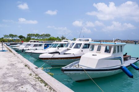 Speedboats at island wharf. Travel destinations. Nobody 스톡 콘텐츠