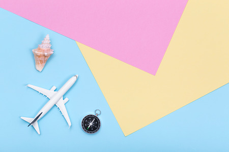 Travel and Vacations objects on pastel colored paper texture, flat lay